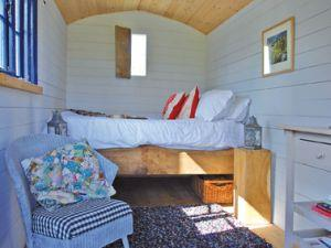 A super comfy double bed is built into the hut