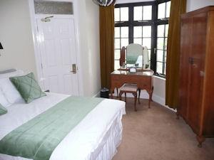 The Royal suite double bedroom
