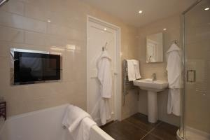 Luxury ensuite with TV embedded in the wall